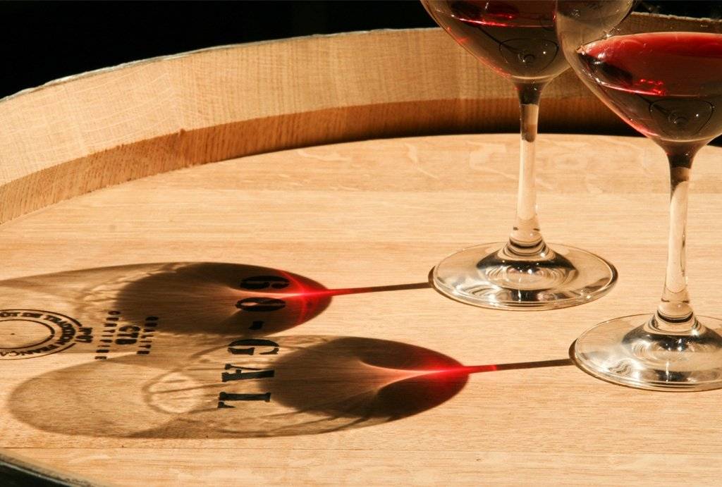 Glasses of Pinot Noir Atop a Wine Barrel