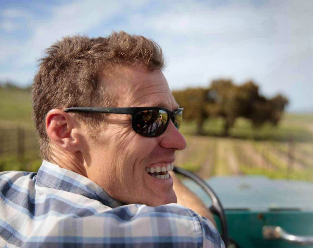 Mark Pisoni drives the jeep through the Pisoni Vineyards