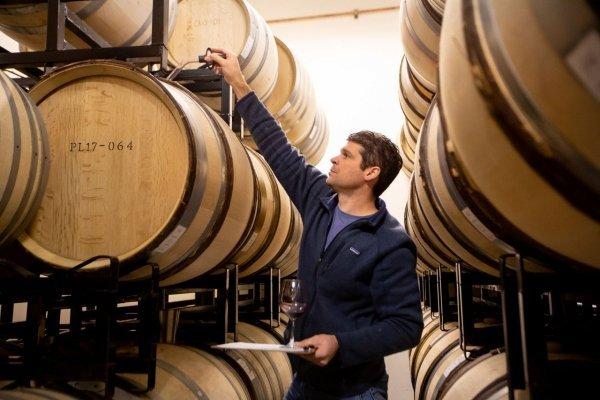 Jeff Pisoni with Lucia Vineyards wine